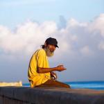 elderly Man string fishing at the Havana's Harbor.