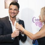 Event photographer Nikolay Mirchev captures Cindy Harvey from Famous Branding interviewing Peter Andre