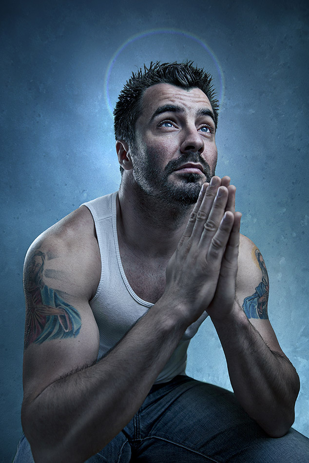 Creative Portrait Of A Man With Tattoos Sitting And Preying By London Photographer Nikolay Mirchev