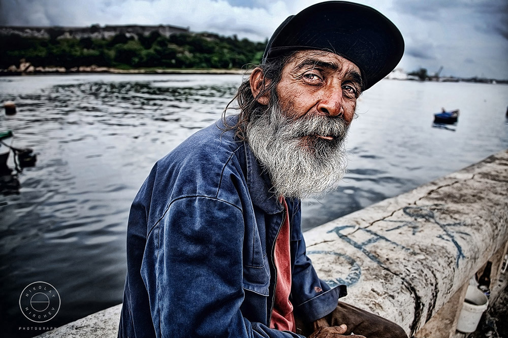 Fisherman Sitting Down Near the Port of Havana Cuba