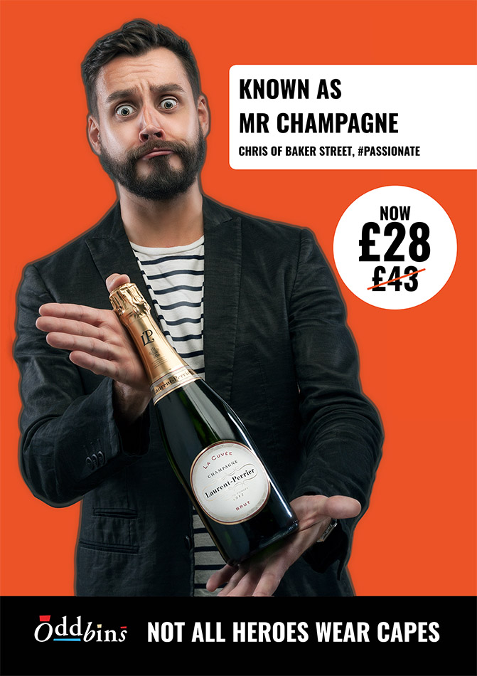 man with beard holding bottle of wine for an advertising campaign for OddBins